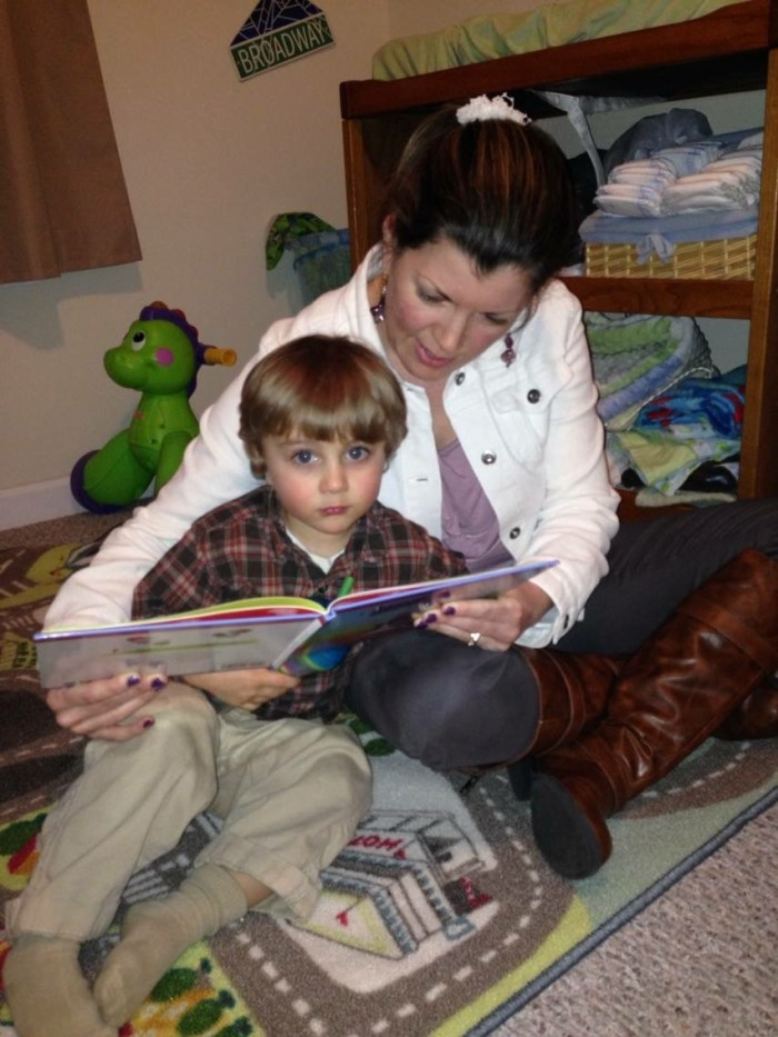 Desiree reading to her son